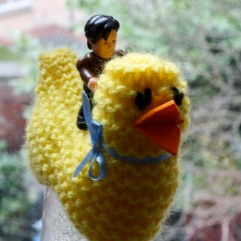 Watch Doctor Who on iPlayer - represented here by a small Matt Smith figurine riding an Easter Chick.