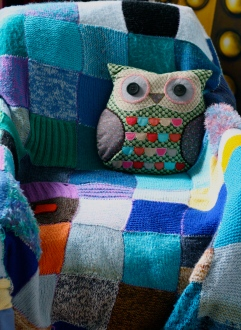 Reading chair, covered in mostly blue blanket I knitted. The owl is Professor Lindsay.