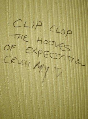 Toilet graffiti artist masters the art of the cliffhanger