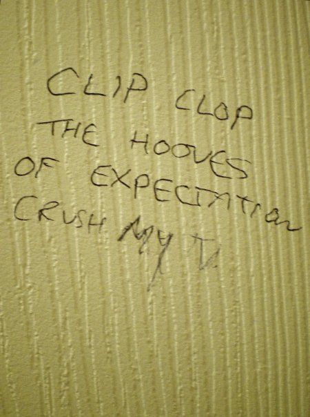 Toilet graffiti artist masters the art of the cliffhanger