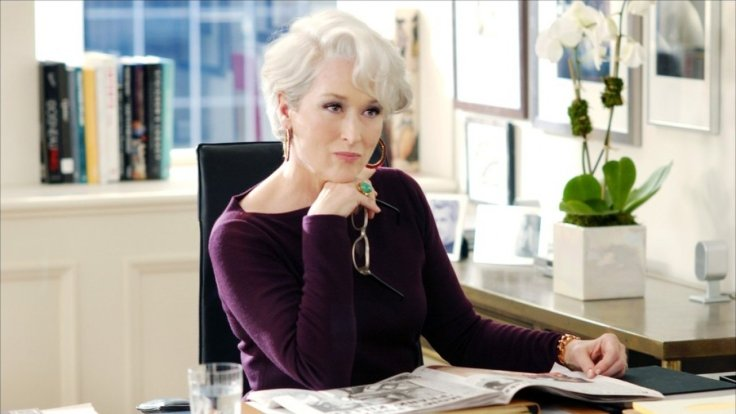 Glenn Close sitting at a desk in The Devil Wears Prada