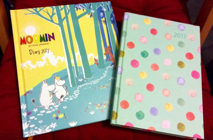 Two 2017 diaries - left, cover with Moomin and Snorkmaiden walking up a hill; right, polka dots on a green background